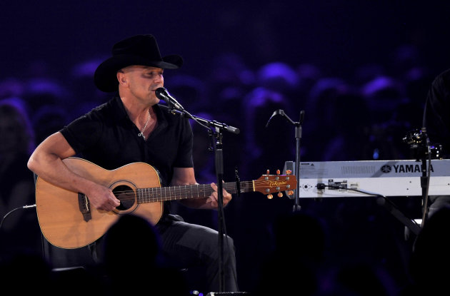 Kenny Chesney performs &quot;One Step Up&quot; at the MusiCares Person of the Year tribute honoring Bruce Springsteen at the Los Angeles Convention Center on Friday Feb. 8, 2013, in Los Angeles. (Photo by Chris Pizzello/Invision/AP)