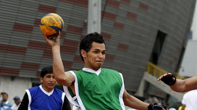 Patients at the Rehabilitation Institute play handball during a parasports workshop in Lima