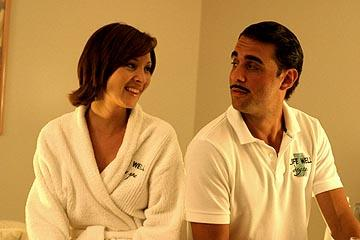 Lisa Kudrow as Mamie and Bobby Cannavale as Javier in Lions Gate's Happy Endings