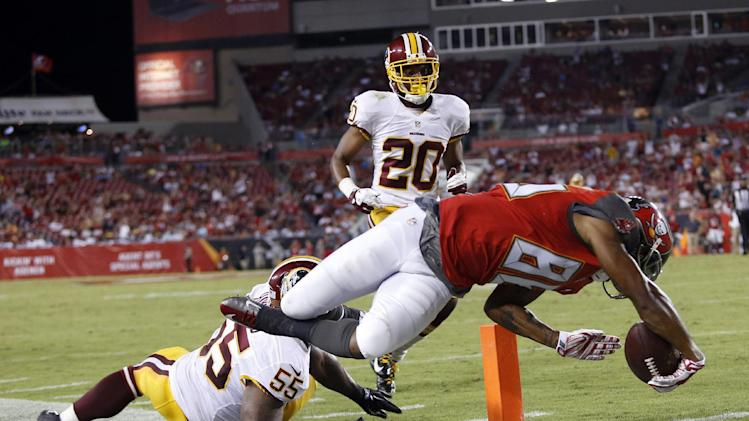 Tampa Bay Buccaneers wide receiver Solomon Patton (86) dives past Washington Redskins outside linebacker Adam Hayward (55) and cornerback Richard Crawford (20) to score on a 25-yard touchdown reception during the third quarter of an NFL preseason football game Thursday, Aug. 28, 2014, in Tampa, Fla