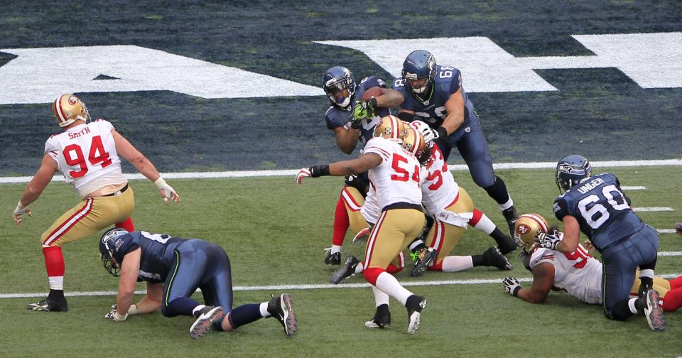 Seattle Seahawks' Marshawn Lynch is brought down inside the 5-yard line against the San Francisco 49ers during the first half of an NFL football game, Saturday, Dec. 24, 2011 in Seattle. (AP Photo/John Froschauer)