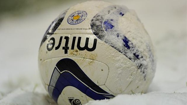 A Leicester City football rests in the snow (PA)