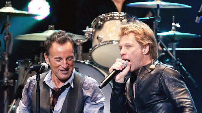 This image released by Starpix shows Bruce Springsteen, left, and Jon Bon Jovi performing at the 12-12-12 The Concert for Sandy Relief at Madison Square Garden in New York on Wednesday, Dec. 12, 2012. Proceeds from the show will be distributed through the Robin Hood Foundation. (AP Photo/Starpix, Dave Allocca)
