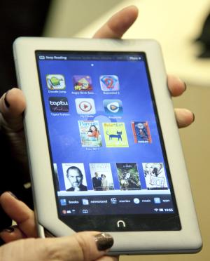 FILE - In this Nov. 7, 2011 file photo provided by Barnes & Noble a demonstrator holds the new Barnes & Noble Nook Tablet following a news conference in New York. Tablets are the most-desired electronic device this holiday shopping season, second only to clothing as the gift people are craving most. (AP Photo/Barnes & Noble, Jim Sulley, File)