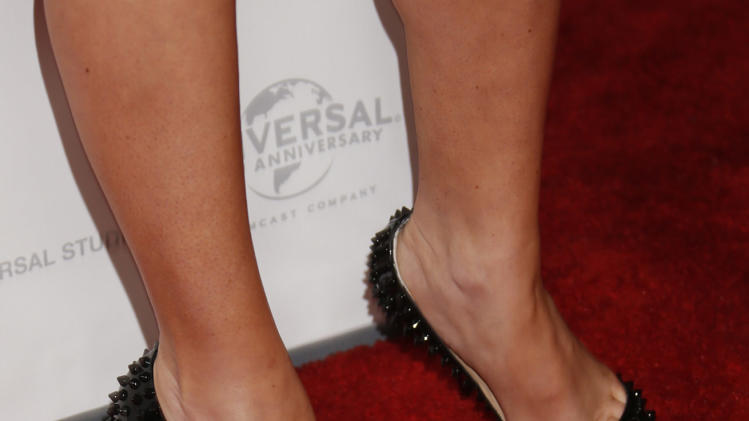 "Megan Fox's shoes the premiere of ""This Is 40"" at Grauman's Chinese Theatre on Wednesday, Dec. 12, 2012, in Los Angeles. (Photo by Todd Williamson/Invision/AP)"