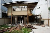 File photo of the damage caused by a blast at the house where suspected bombers were allegedly planning attacks on Israeli targets in Bangkok in February 2012. Several Iranian suspects have been held over incidents in Bangkok that saw Tehran accused of a terror campaign against Israel -- which has it denied