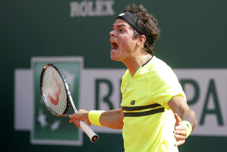 Canada's Milos Raonic reacts during his match of the Monte Carlo Tennis Masters tournament in Monaco against Jarkko Nieminen of Finland, Wednesday, April 17, 2013. (AP Photo/Lionel Cironneau)