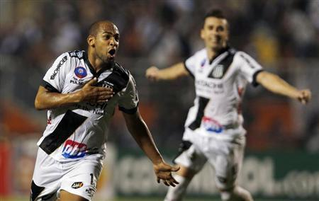 Bastos of Brazil's Ponte Preta celebrates after he scored a goal during their Copa Sudamericana first leg final soccer match against Argentina's Lanus in Sao Paulo