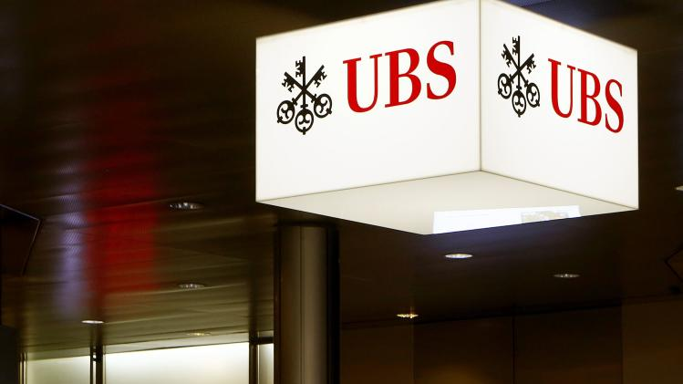 A man walks past an office of Swiss bank UBS in Zurich