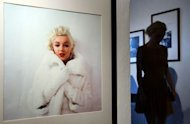 A woman walks past photos of Marylin Monroe by late celebrity photographer Milton H. Greene at an exhibition in Warsaw. As fans worldwide mark 50 years since her untimely death, a collection of rare Marilyn Monroe photographs immortalising the American blonde bombshell went on display in Warsaw Monday