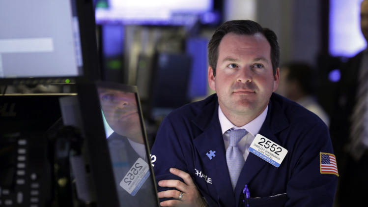 Specialist Charles Boeddinghaus works at his post on the floor of the New York Stock Exchange Tuesday, May 7, 2013. The Dow Jones industrial average punched through another milestone Tuesday: its first close above 15,000. (AP Photo/Richard Drew)