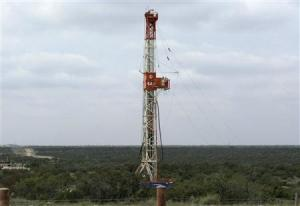 A rig contracted by Apache Corp drills a horizontal well in a search for oil and natural gas in the Permian Basin in West Texas