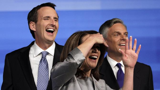 Republican presidential candidates former Minnesota Governor Tim Pawlenty, left, Rep. Michele Bachmann, R-Minn., center, and former Utah Gov. Jon Huntsman are seen before the start of the Iowa GOP/Fox News Debate at the CY Stephens Auditorium in Ames, Iowa, Thursday, Aug. 11, 2011. (AP Photo/Charlie Neibergall)