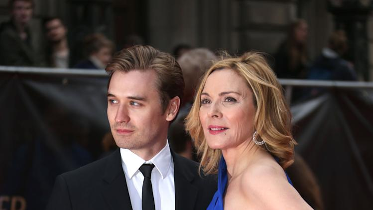 Kim Cattrall and Seth Numrich  pose on arrival at the Olivier Awards 2013 at the Royal opera House in London on Sunday, April 28th, 2013. (Photo by Joel Ryan/Invision/AP)