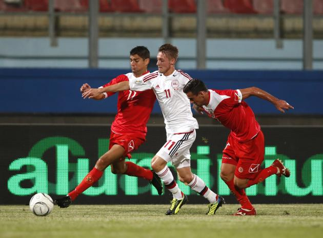 Malta's Herrera and Failla tackle Denmark's Falk during their 2014 World Cup qualifying soccer match in Ta' Qali