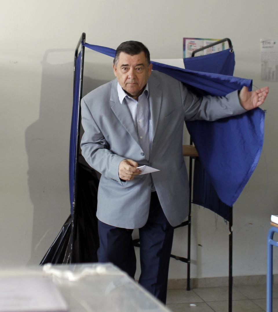 Leader of the right-wing LAOS party George Karatzaferis exits a polling booth at a polling station in Athens, on Sunday, June 17 2012.  Greeks are voting Sunday for the second time in six weeks in what is arguably their country's most critical election in 40 years. (AP Photo/Kostas Tsironis)