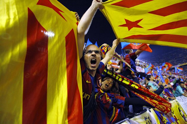 FILE- In this April 20, 2011, file photo, Barcelona fans wave pro-independence Catalonia flags during the final of the Copa del Rey soccer match between Real Madrid and FC Barcelona at the Mestalla stadium in Valencia, Spain. More than ever, FC Barcelona, known affectionately as Barca, lived up to its motto of being &quot;more than a club&quot; for this wealthy northeastern region where Spain&#39;s economic crisis is fueling separatist sentiment. Barca has been seen as a bastion of Catalan identity dating back to the three decades of dictatorship when Catalans could not openly speak, teach or publish in their native Catalan language. Barcelona writer Manuel Vazquez Montalban famously called the football team &quot;Catalonia&#39;s unarmed symbolic army.&quot; (AP Photo/Andres Kudacki, File)