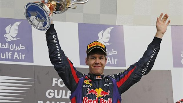 Red Bull Formula One driver Sebastian Vettel of Germany celebrates with the winner's trophy during the victory ceremony of the Bahrain F1 Grand Prix at the Sakhir circuit, south of Manama April 21, 2013 (Reuters)