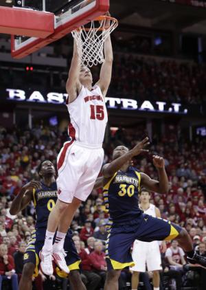 No. 8 Wisconsin holds off Marquette, 70-64
