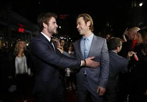 "Cast member Hemsworth greets his brother at the premiere of ""Thor: The Dark World"" in Hollywood"