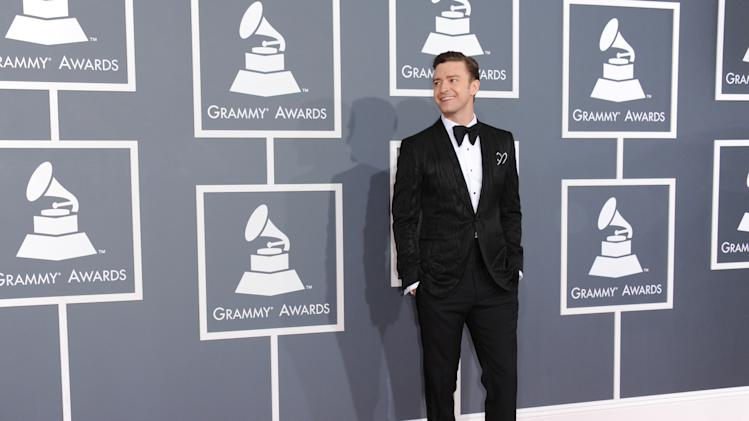 "FILE - In this Feb. 10, 2013 file photo, musician Justin Timberlake arrives at the 55th annual Grammy Awards, in Los Angeles.  ""Mad Men"" star Jon Hamm is going mad over Justin Timberlake's suit and tie, the song and the singer's style. As for Timberlake, Hamm believes the pop star has ""always been a very fashion forward kind of guy."" (Photo by Jordan Strauss/Invision/AP, File)"