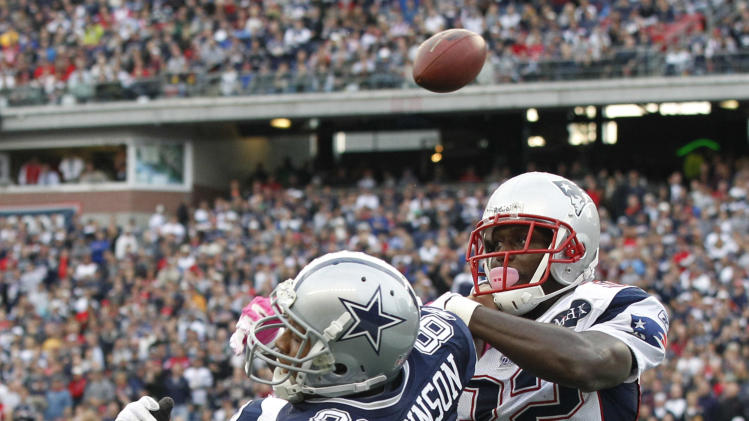 New England Patriots cornerback Devin McCourty (32) breaks up a pass in the end zone intended for Dallas Cowboys wide receiver Laurent Robinson (81) during the first half of an NFL football game in Foxborough, Mass., Sunday, Oct. 16, 2011. (AP Photo/Elise Amendola)