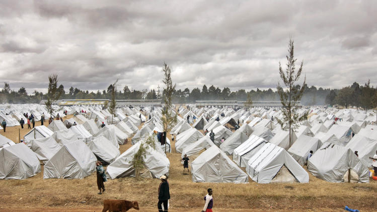 FILE - In this Saturday, Jan. 19, 2008 file photo, a sea of tents made out of plastic sheeting fills a camp for the displaced in the showground in Eldoret, Kenya, following post-election violence. A treaty that African nations hope will lead to the fair and humane treatment of people displaced in their own countries went into force Thursday, Dec. 6, 2012, more than three years after it was conceived by the African Union. (AP Photo/Ben Curtis, File)