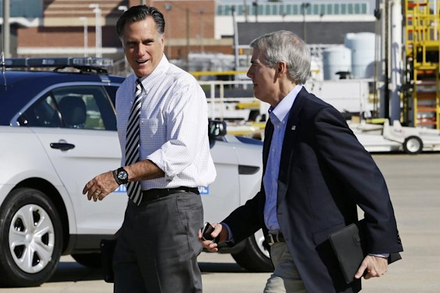 Republican presidential candidate, former Massachusetts Gov. Mitt Romney walks with Sen. Rob Portman, R-Ohio, as he arrives in Richmond, Va., Friday, Oct. 12, 2012. (AP Photo/Charles Dharapak)