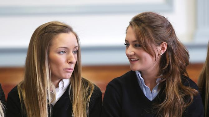 Rachel Canning, right, sits with her friend Jamie Inglesino during a hearing at the Morris County Courthouse, Tuesday, March 4, 2014, in Morristown, N.J. Canning, an honor student who says her parents kicked her out of the house when she turned 18, is now suing them, asking a court to make them support her and pay for her college. (AP Photo/The Star-Ledger, John O'Boyle, Pool)