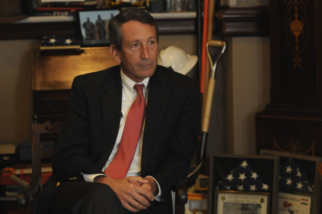 In this Tuesday, Dec. 14, 2010 photo, S.C. Gov. Mark Sanford talks with Associated Press reporters in his office in Columbia, S.C. about his time in office and his future.