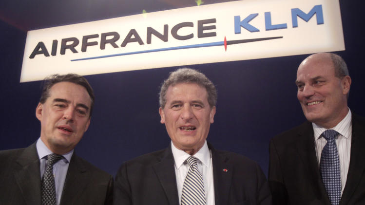 "CEO of Air France-KLM, Jean-Cyril Spinetta, center, CEO of Air France, Alexandre de Juniac, left, and Peter Hartman President and CEO of KLM, right, pose as they arrive for a press conference to announce the full year results in Paris, Thursday, March 8, 2012.  Air France-KLM on Thursday reported a multimillion euro loss for 2011, which the struggling carrier called a ""tough year"" beset by volatile fuel prices, political upheaval and a lackluster global economy. (AP Photo/Michel Euler)"