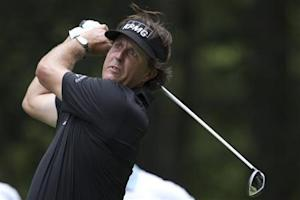 Phil Mickelson of the U.S. tees off on the ninth hole during the second round of the Deutsche Bank Championship golf tournament in Norton