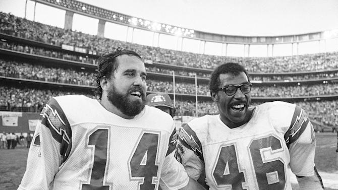 FILE - In this Jan. 5, 1980, file photo, San Diego Charges quarterback Dan Fouts (14) and running back Chuck Muncie (46) flash big smiles as they leave field following the Chargers 20-14 over the Buffalo Bills in an NFL football playoff game in San Diego. The New Orleans Saints announced Tuesday, May 14, 2013, that  Muncie, a Pro Bowl running back with both the Saints and Chargers, has died. He was 60.  (AP Photo/File)