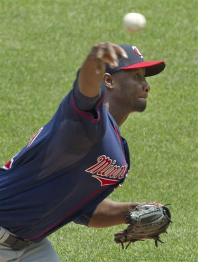 Doumit homers from both sides, Twins beat Royals