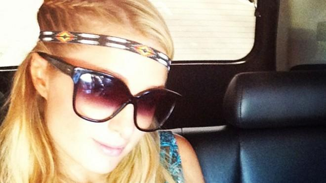 Paris Hilton returns to her true talent: Making selfies... er, albums.