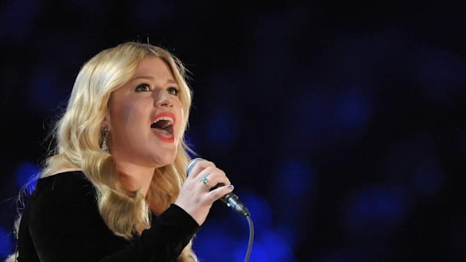 FILE - In this Sunday, Feb. 10, 2013 file photo, Kelly Clarkson performs on stage at the 55th annual Grammy Awards in Los Angeles. Co-hosts Blake Shelton and Luke Bryan will perform during this year's Academy of Country Music Awards, it was announced Wednesday, March 6, 2013, and will be joined by Shelton's wife, Miranda Lambert, George Strait, Kelly Clarkson, Hunter Hayes and The Band Perry. The awards broadcast live on April 7, 2013 on CBS. (Photo by John Shearer/Invision/AP, File)