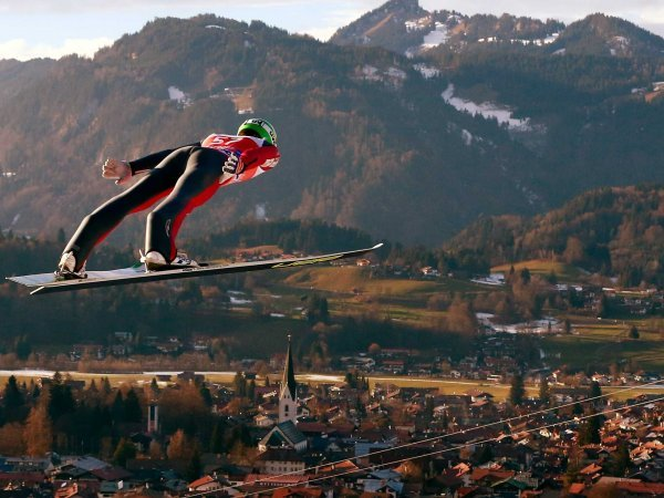 Peter Prevc from Slovenia soars through the air, ski jumping
