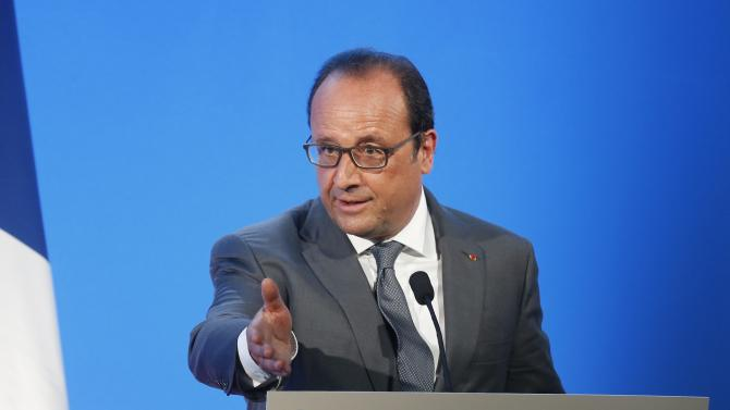 French President Francois Hollande delivers a speech during a visit at the Groupe Le Marais primary school on the first day of the new school year in Pouilly-sur-Serre