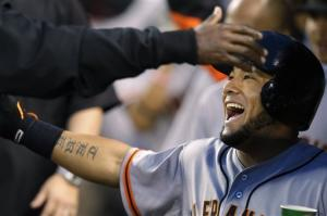 Posey, Cabrera lead Giants past Mariners 4-2