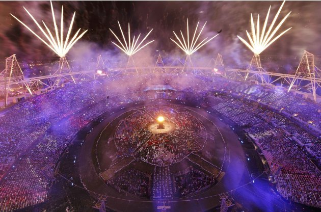 Fireworks explode over the lit Olympic Cauldron during the opening ceremony of the London 2012 Olympic Games at the Olympic Stadium