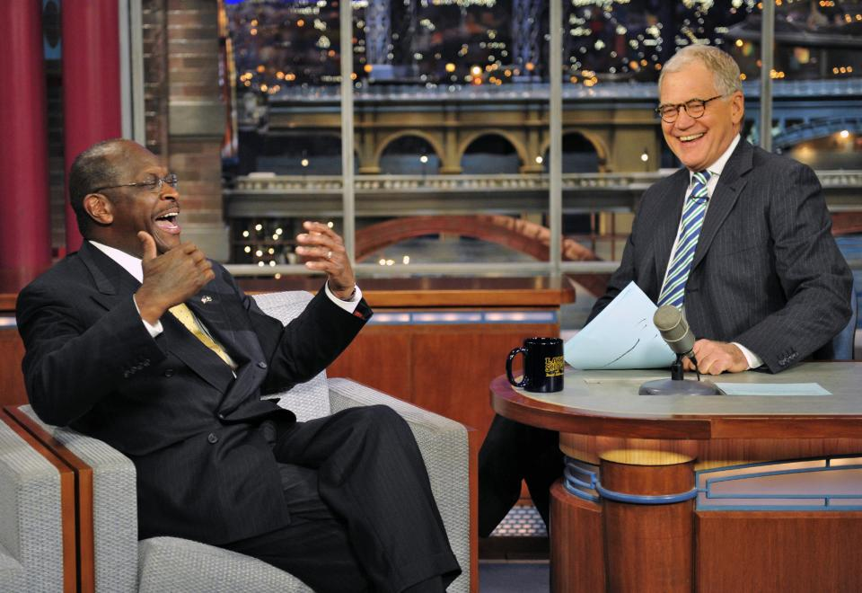 "In this photo provided by CBS, Republican presidential candidate Herman Cain joins host David Letterman on the set of the ""Late Show with David Letterman,"" Thursday, Nov. 17, 2011 in New York. The show airs Friday, Nov. 18. (AP Photo/CBS, John Paul Filo)"