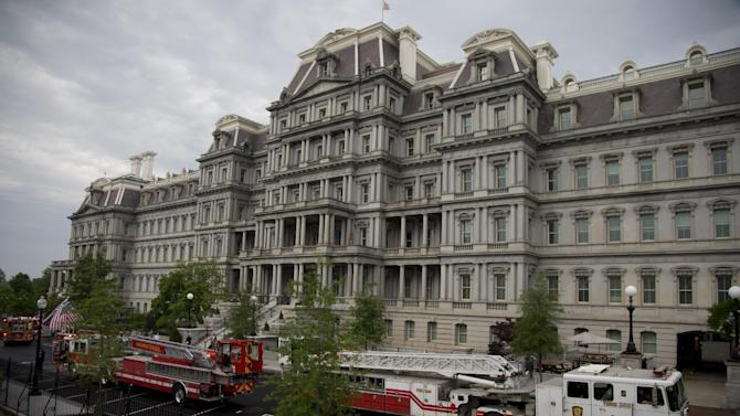 District of Columbia Fire department trucks and personnel are seen parked between the The Eisenhower Executive Office Building and the West Wing as they respond to a call at the White House, Saturday, May 11, 2013, in Washington. The West Wing including the media area were evacuated because of smoke according to Secret Service Uniformed Division. Journalists were sent outside shortly after 7 a.m. while firefighters inspected the West Wing. They were allowed back into the building about an hour later. (AP Photo/Carolyn Kaster)