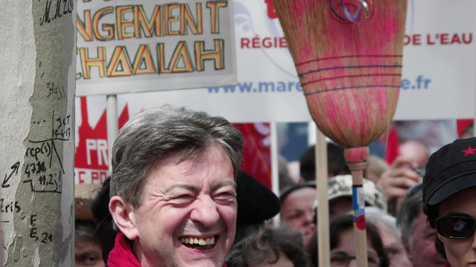 Leader of the French leftist party, Jean Luc Melenchon, smiles before a rally to protest against the austerity measures announced by the French government, in Paris, Sunday, May 5, 2012. (AP Photo/Michel Spingler)