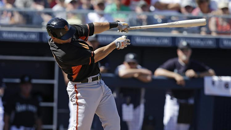 San Francisco Giants' Juan Perez hits a home run during the second inning of a spring exhibition baseball game against the Seattle Mariners Saturday, March 15, 2014, in Peoria, Ariz