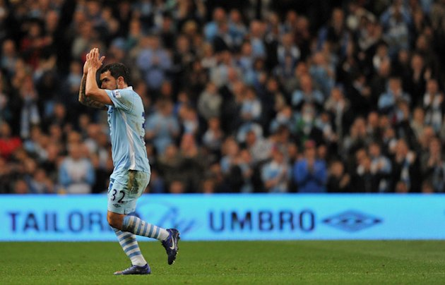 Manchester City's Argentinian Footballer Carlos Tevez Applauds The Crowd As He Is Substituted Against Manchester United AFP/Getty Images