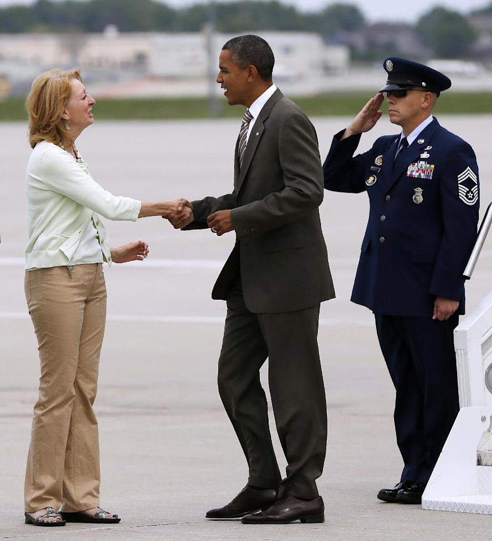 President Barack Obama is greeted by former Iowa Attorney General Bonnie Campbell on the tarmac upon his arrival at Des Moines International Airport, Saturday, Sept. 1, 2012, in Des Moines, Iowa. (AP Photo/Pablo Martinez Monsivais)