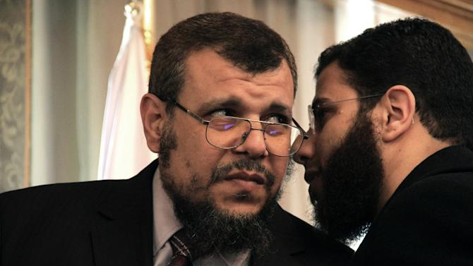 "Khaled Alam Eldin, left, who was fired Sunday from his post as adviser to the Egyptian president for environmental affairs, consults with the Salafist Al-Nour party spokesman, Nader Bakkar during a televised press conference in Cairo, Egypt Monday, Feb. 18, 2013. Alam Eldin broke down in tears while denying he had abused his office and demanded an apology from President Mohammed Morsi calling the firing ""political."" It is the latest sign of tension between Morsi's Muslim Brotherhood and its Islamist ally ahead of parliamentary elections expected in the coming months. (AP Photo/Mostafa El Shemy)"