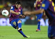 FC Barcelona's Lionel Messi from Argentina kicks the ball against Napoli during the Joan Gamper trophy at the Camp Nou stadium in Barcelona, Spain, Monday, Aug. 22, 2011. (AP Photo/Manu Fernandez)