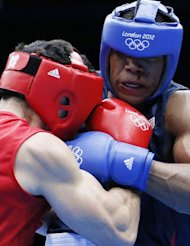 Michael Hunter II (R) of the USA defends against Artur Beterbiev (L) of Russia during their round of 16 Heavyweight (91kg) boxing match of the London 2012 Olympics at the ExCel Arena in London. Beterbiev won a close points decision
