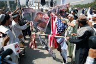 "<p>Afghan demonstrators burn US flags and photos of actors and actresses who took part in the film ""Innocence of Muslims"" during a protest in Kabul. The US government compiled a YouTube film of ordinary Americans condemning ""Innocence of Muslims.""</p>"